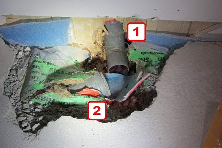 Aus der Wand zum Hauswirtschaftraum kommt ein Rohr (1), das mit dem im Fußboden des Kellerraums (2) verbunden sein sollte.