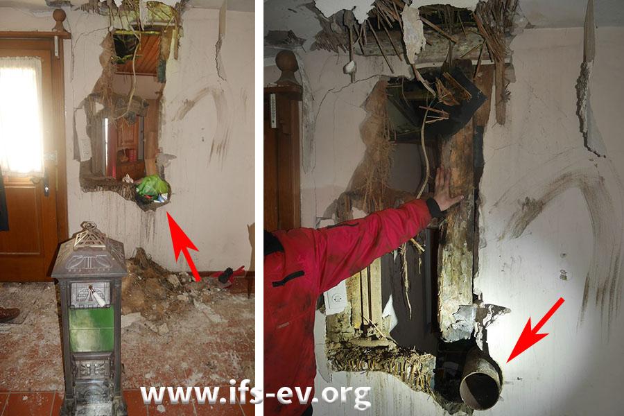 Der Ofen im Flur mit der dahinter geöffneten Wand. Die Pfeile markieren die Stelle, an der das Rauchrohr durch die Wand geführt wurde.