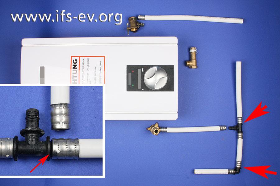 Ein defekter Durchlauferhitzer und mehrere ganz oder teilweise (Pfeile) getrennte Pressverbindungen