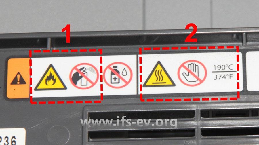 Im Drucker weisen Piktogramme auf die Brandgefahr (1) und heiße Oberflächen (2) hin.